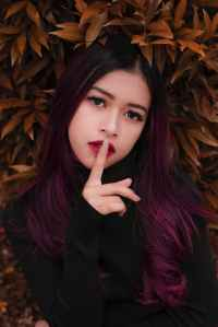 woman s index finger on her lips
